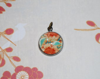 Medallion orange red flowers
