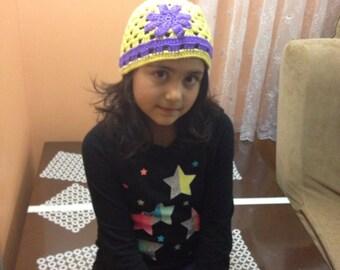 Yellow girls hat with purple flower