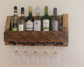 Handmade six bottle wine rack and section for hanging glasses.