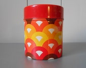 Small vintage 70s tin canister / container with retro psychedelic pattern in orange, red, brown and yellow