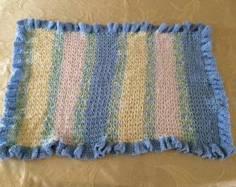 crochet baby crib blanket is blue, multi, yellow, white