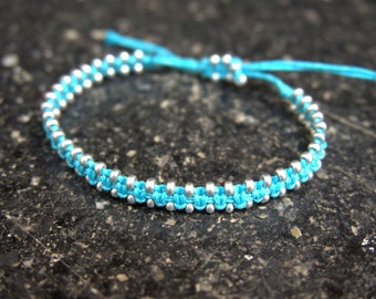 Knotted turquoise bracelet with silver beads