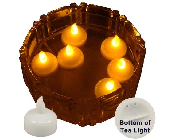 amber led floating waterproof candles tea light by bluedottrading. Black Bedroom Furniture Sets. Home Design Ideas