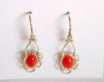 Delicate dangle earrings with oxblood coral in sterling silver.