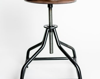 Handmade industrial swivel stool, steel and natural leather.