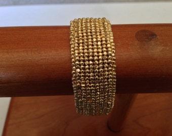 Gold seed bead bracelet.
