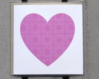 Greeting card with pink love heart