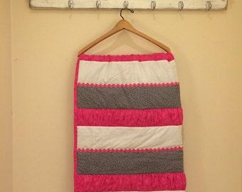 Modern stripped baby quilt.