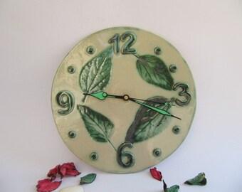 Handmade ceramic clock with leaf design
