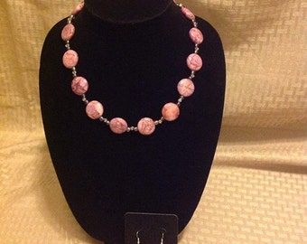 Magenta stone necklace. Adjustable length.