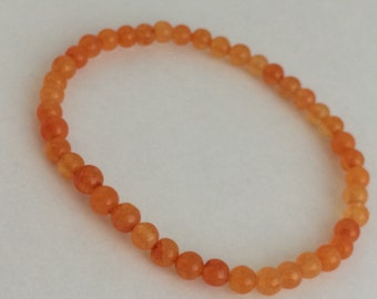 Orange round dye quartzite women's stretch bracelet