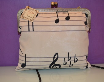 bag stamped with musical motifs and nozzle closure