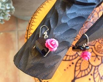 Blue/purple Goldstone Heart shaped earrings with a single hot pink rose