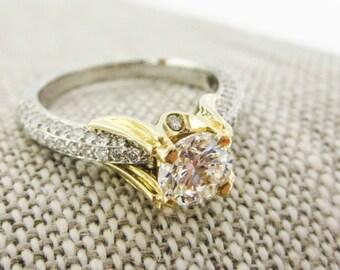 PLATINUM and 18k gold, diamond engagement ring