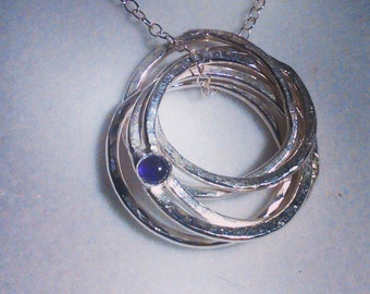 Sterling Silver hammered pendant with Amethyst cabochon birthstone on Sterling Silver chain.