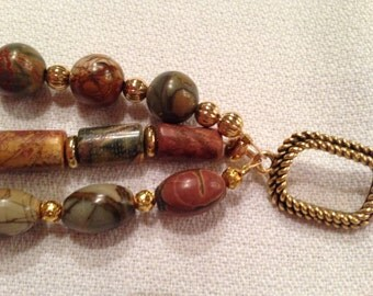 Rich earth tone three strand beaded bracelet with gold tone findings