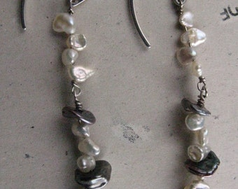 Earrings in sterling silver with black and white keshi pearls.