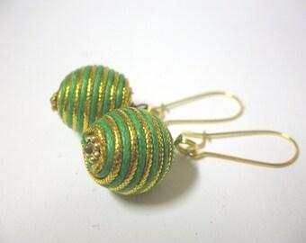 Green Golden textile ball earrings