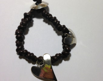 Leather bracelet with silver accesories