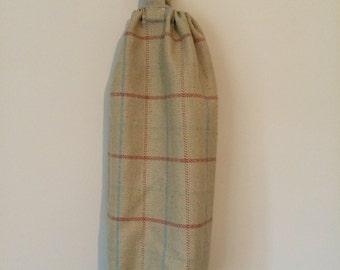 Tweed Carrier bag holder.