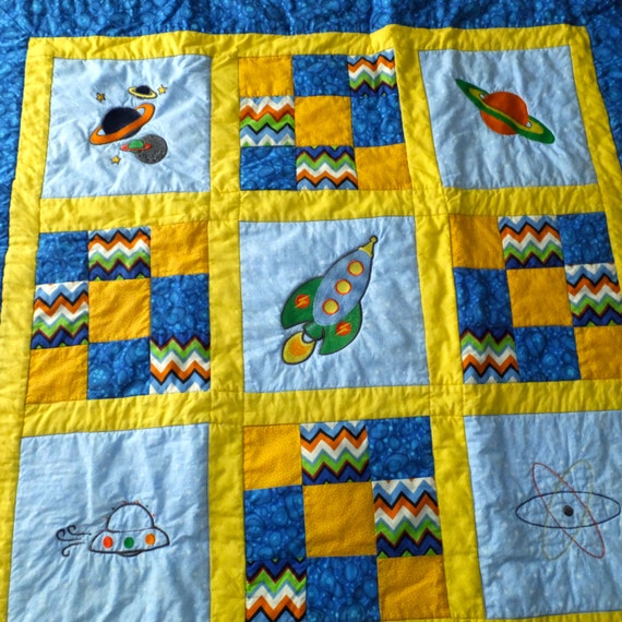 Baby boy quilt homemade baby quilt space theme by duckwells for Space baby fabric