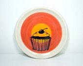 little plate cupcake in colour block of red-orange & orange, already made.