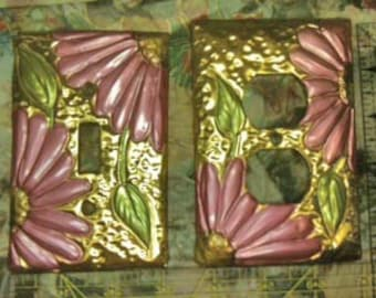 Brass tone switch cover set with pink gerber daisies