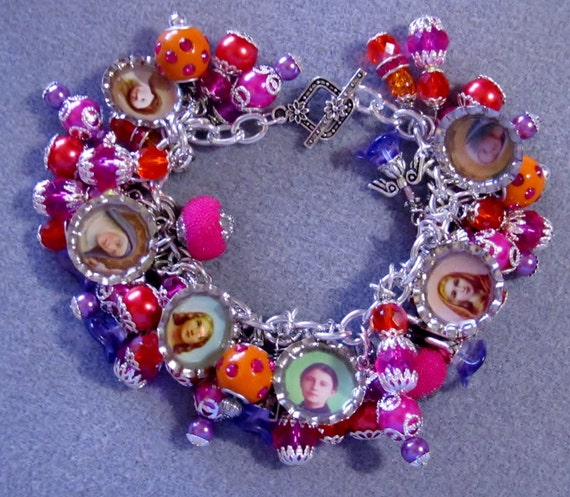 catholic saints bracelet catholic saints loaded charm bracelet pink orange fuschia 2314