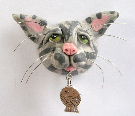 Gray striped tiger cat with fish refrigerator by for Tiger striped fish