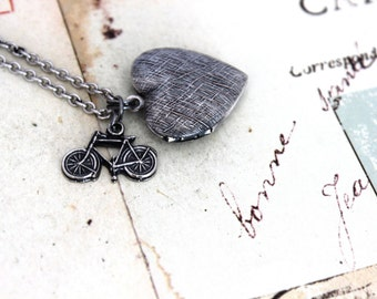 bike. heart locket necklace. in silver ox with etched lines locket