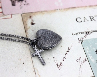 cross. heart locket necklace. in silver ox with etched lines locket
