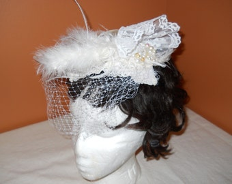 white fascinator      made with feathers and lace