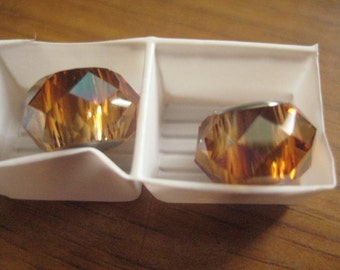 One 14mm Crystal Copper Swarovski Bead with Stainless Steel Center