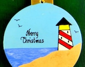 0027 Lighthouse ball.Message shown is a suggestion. Ornaments can be written with a message/name of your choice. All ornaments are dated