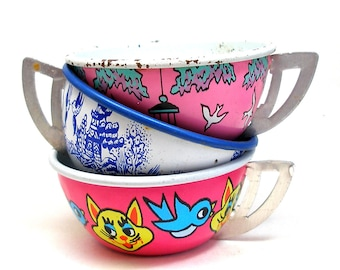 Tin Toy Tea Cups & Saucers, CAT and Birds in pink, blue, white.