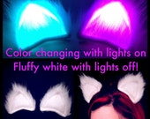 Clip On Color Changing LED Cat Ears, Glow In The Dark Fluffy White Costume Multicolor Cosplay Ravewear Gift. EDC Outfit Light Up Burning Man