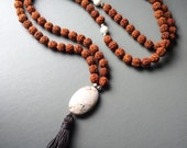 rudruksha 108 bead mala prayer necklace with grey tassel and agate focal touch stone