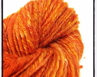 Handspun wool/silk blend makes a lovely fabric knit or woven into your very own masterpiece. Perfect gift for knitters. 1.7oz orange