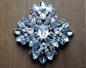 Large signed SHERMAN Ice Blue Crystal Rhinestone Brooch
