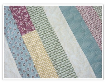 """Sale was 225.00 now 199.00   Twin Size Quilt, strip quilt, scrappy strips, 81""""x63 1/2"""", machine quilted, jelly role quilt, teal, brown"""