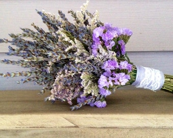 Simple dried flower bridal bouquet with dried Lavender, Caspia and Statice. Wrapped with lace.