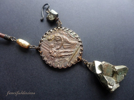 Protect the Mothers. Rustic assemblage necklace with antique medal and pyrite.