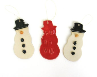 collection of whimsical handbuilt porcelain ornaments  ...   snowman  ...   3 snowmen