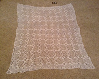 Vintage hand crocheted tablecloth.