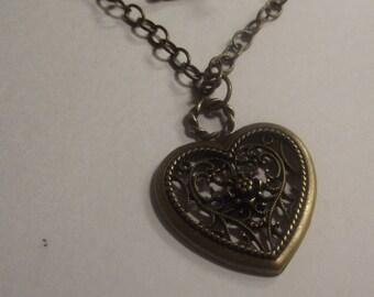 Filigree Antique bronze Heart Pendant on a Delicate Chain Necklace