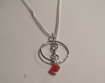 Red and Silver Circular Pendant Necklace on bright silver tone Chain with Bright red Glass Crystal dangle
