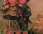 Old fashioned children holding a kitty inside a   medium Panoramic Sugar egg sale