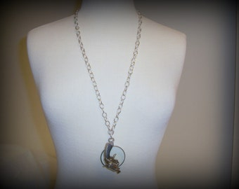 Upcycled Handmade Magnifier Necklace with a Vintage MiniatureToy Gun