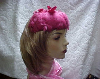 SALE  Pink feather fascinator hat with velvet bow on top.