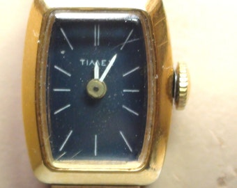 "Timex  Watch Bracelet Wind Up  RETRO Mechanical  and is Working 18K Gold  Plated and 17 Jewels Open size from 4"" up to 7"""